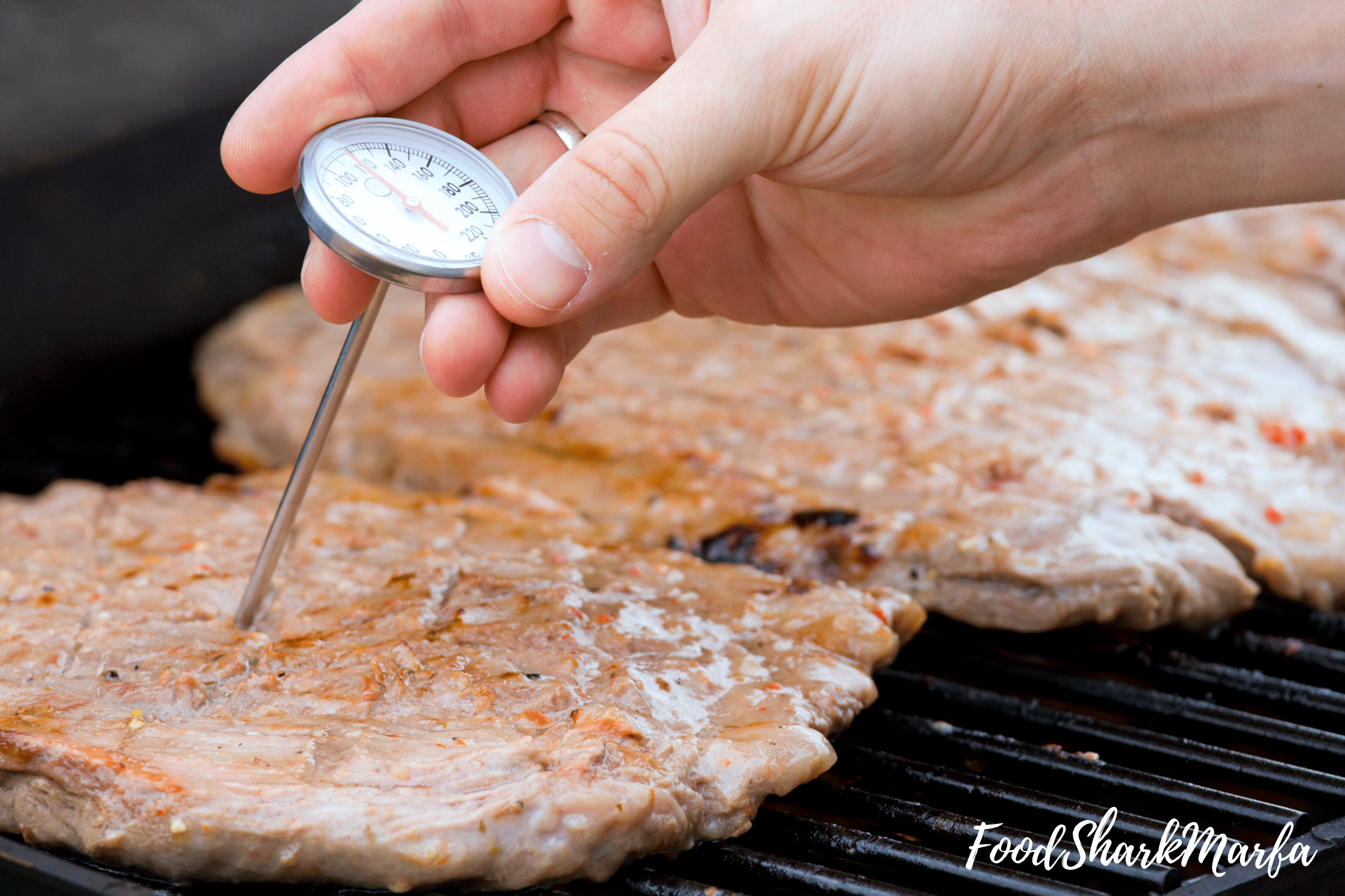 read-meat-thermometer-to-chicken-is-cooked-to-a-safe-internal-temperature