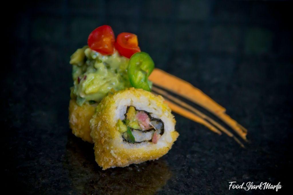 Fried maki sushi piece with guacamole